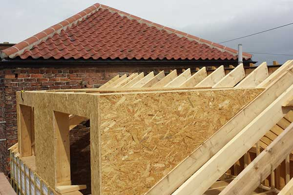 Raised collar roof joists and domer roof extension